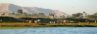 I love this scene. A classic Nile River setting. Children playing futball, awaiting the ball's return from high in the sky. Onlookers include donkeys and camels.
